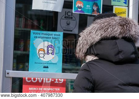 Montreal, Ca - 13 February 2021: Signage Showing Covid-19 Safety Guidelines On Store Door As A Custo