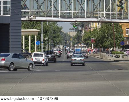 Kazakhstan, Ust-kamenogorsk, June 12, 2020: Traffic. One Of The City Streets. Cars, People. Cityscap