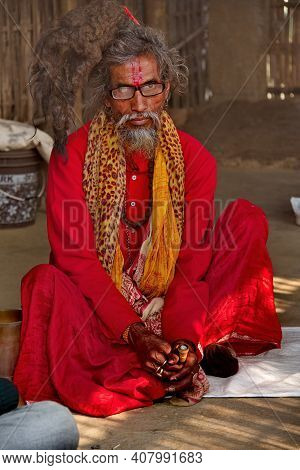 Guwahati. India. February 11, 2016. A Pilgrim With An Exotic Hairstyle On His Head In Bright Clothes