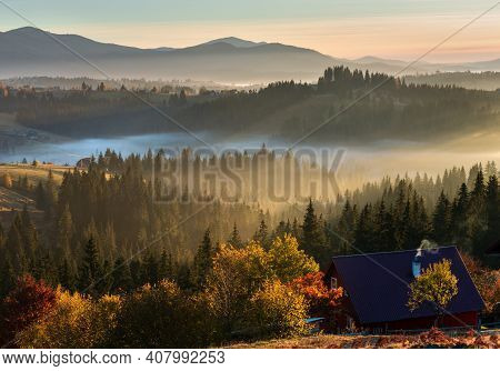 The Air. Early Morning Fog And First Morning Sun Rays Over The Autumn Slopes Of Carpathian Mountains