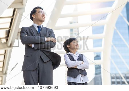 Business Father And Son Arms Crossed And Look At City With Proud And Confidence Child Want To Be Lik