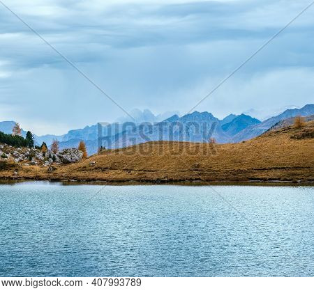 Overcast Morning Autumn Alpine Dolomites Mountain Scene. Peaceful Valparola Path And Lake View, Bell