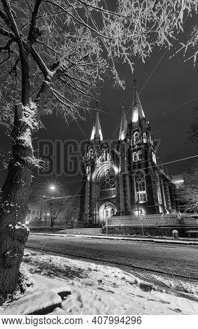 Grayscale. Beautiful Illuminated Night Winter Church Of Sts. Olha And Elizabeth In Lviv, Ukraine. Bu