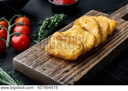 Chicken Breast Nuggets Fried On Black Wooden Background.