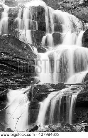 Grayscale. Waterfalls On Rocky Stream, Running Through Autumn Mountain Forest.
