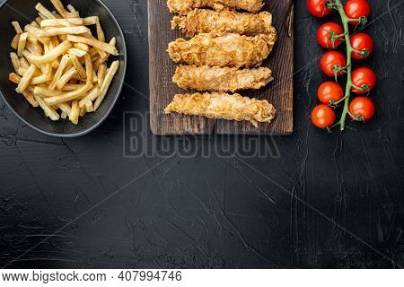 Crispy Chicken Tenders Cuts On Black Background, Top View, With Space For Text.