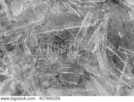 Grayscale. Many Elongated Pieces Of Ice Closeup. Winter Background.