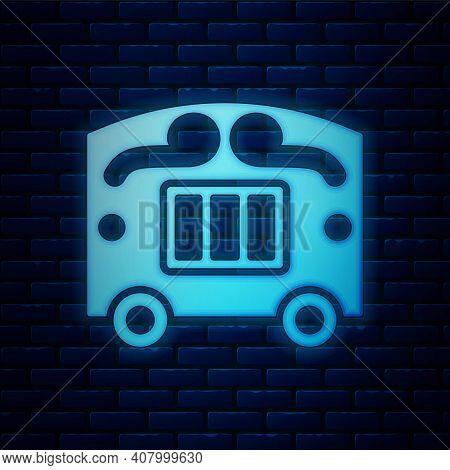 Glowing Neon Circus Wagon Icon Isolated On Brick Wall Background. Circus Trailer, Wagon Wheel. Vecto