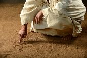 Jesus Writing on the sand with his finger poster