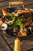 seafood saute a typical Italian soup with seafood sauteed in the pan poster
