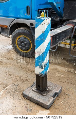 Close up crane outrigger pad in construction site poster