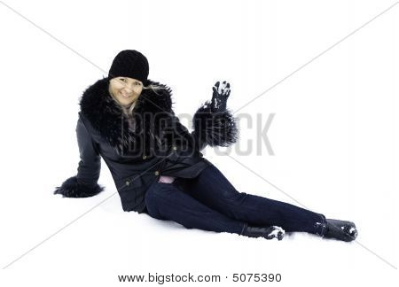 Young Woman Sitting On Snow.