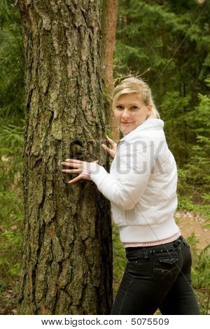Causasian Girl In A Forest.