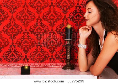 Girl And Canles Romatic Fashion Glamour Woman Looking At Two Candles On A Fireplace