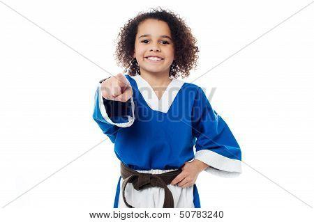 Smiling Karate Girl Pointing Towards You