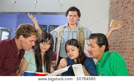 Customers Reading A Menu