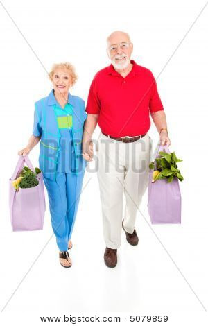Seniors With Reusable Shopping Bags