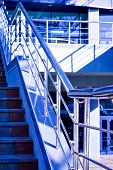 Marble staircase with a steel handrail in a modern building poster