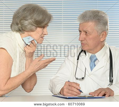 Aged doctor with old patient