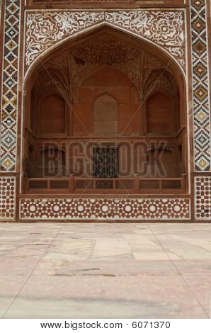 Ornate facade of Akbar's Tomb (the great Mughal emperor). Islamic style architecture. Red sandstone inlaid with white marble. Sikandra Agra India poster
