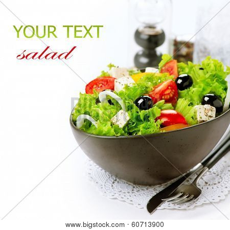 Salad. Greek Salad isolated on a White Background. Mediterranean Salad with Feta Cheese, Tomatoes and Olives. Healthy fresh vegetarian food