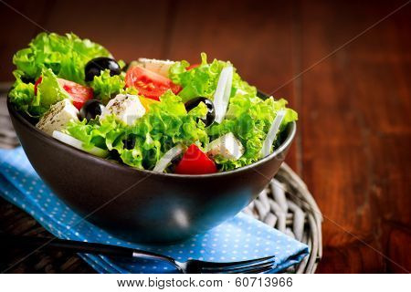 Greek Salad. Mediterranean Salad with Feta Cheese, Tomatoes and Olives. Healthy fresh vegetarian food poster
