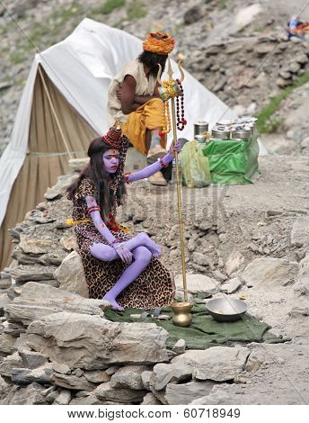 AMARNATH, JAMMU AND KASHMIR, INDIA - JULY 18, 2006: Young sadhu monk symbolizes Shiva god on the way to holy Amarnath cave in Himalayas.