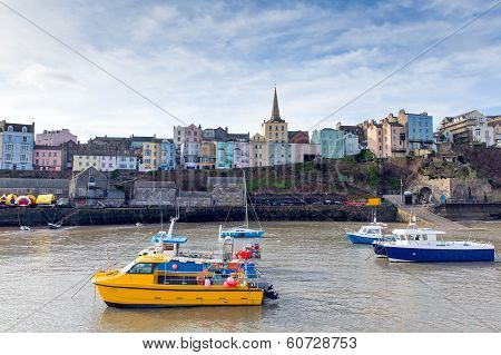 Boats in Welsh harbour of Tenby Pembrokeshire Wales poster
