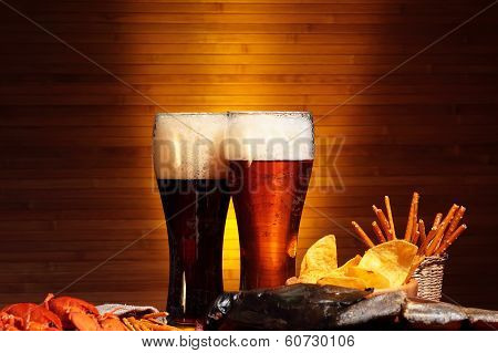 Beer with chips and snacks