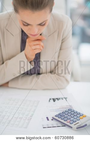 Concerned Business Woman Working With Documents