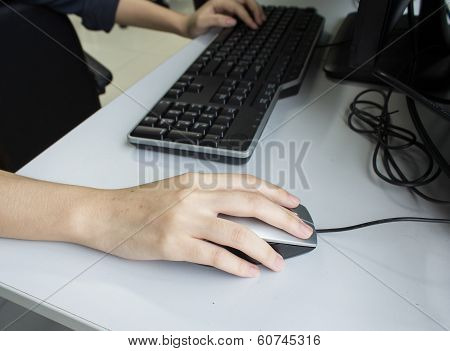 female hands clicking computer mouse