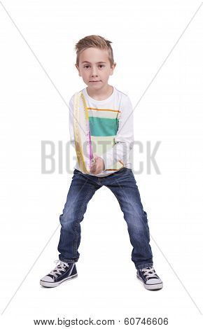 Adorable boy posing with a tennis racket