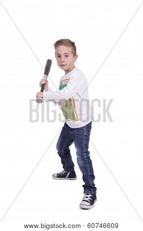 Elementary boy swinging baseball bat