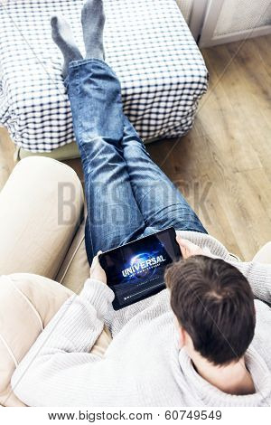 Man watching universal movie on tablet pc