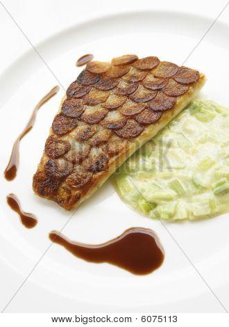 Sea bream with potato scales.