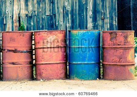 Four Old Barrels For Oil, Petroleum, Red And Blue.