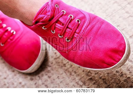 Closeup Of Casual Vibrant Pink Sneakers Shoes Boots On Female Feet