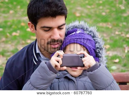 Father And Daughter Taking Photographs