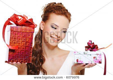 Smiling Girl Choosing Between Two Gifts