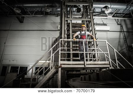 Man in a safety hat on a factory