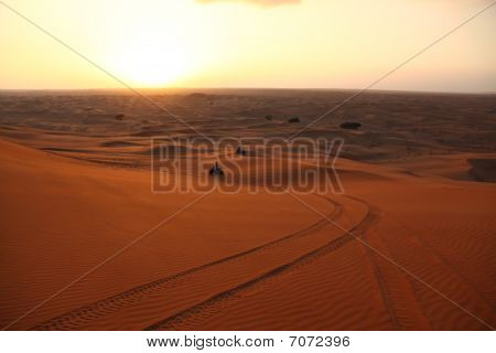 Atv Racing Between The Dunes