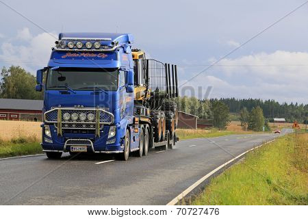 Volvo FH13 Hauls Ponsse Forwarder On The Road