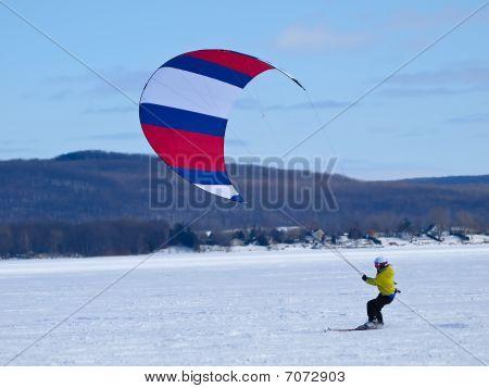 Men ski kiting on a frozen lake poster