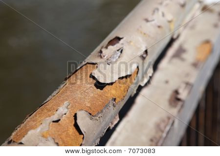 Rust And Peeling Paint On Metal Bar2