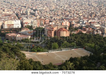 Soccer Field Above Barcelona City Panorama