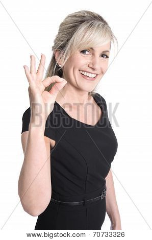 Charming Older Business Woman Making Excellent Symbol With Fingers.