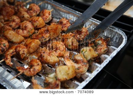 Barbecue Shrimps On Grill With Grippers