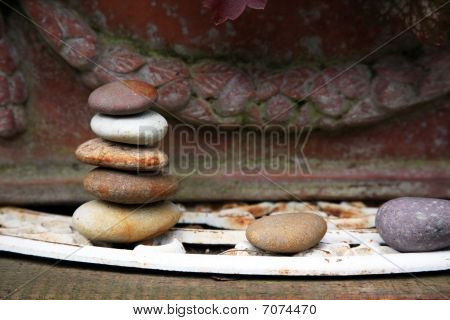 Stacked Stones In Front Of Pot