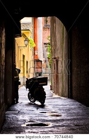 Mail delivery at typical backstreet at downtown of Ferrara, Italy