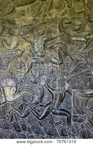 Ancient carvings on walls of Angkor Wat